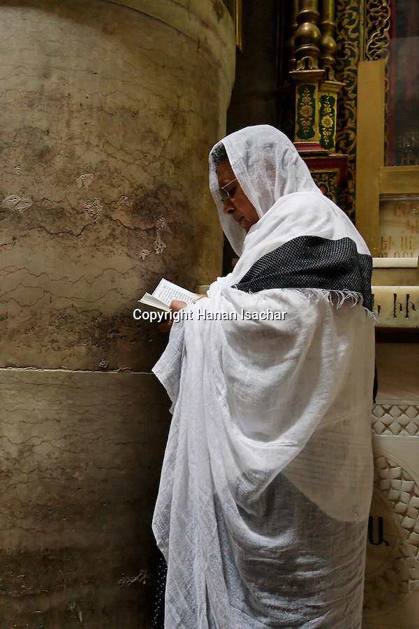 Israel, Jerusalem Old City, a prayer at the Church of the Holy Sepulchre on Good Friday. Easter 2005<br />