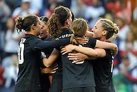 USWNT players celebrate Abby Wambach's opening goal.
