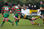 Nigel Watson tackles Sosefo Kata. Counties Manukau Premier Club Rugby game between Pukekohe and Waiuku played at Colin Lawrie Fields, Pukekohe, on Saturday July 3rd 2010. Pukekohe won 31 - 12 after leading 15 - 9 at halftime.