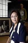 """Yuko Tojo, granddaughter of Japan's wartime leader, General Hideki Tojo, poses with a family photo taken with her grandfather when she was 2 at her home in Tokyo. Gen. Hideki Tojo - who ordered the attack on Pearl Harbor -- was charged and hanged as a war criminal after World War II when Yuko was just 6. Though she remembers little of her grandfather she still regards him as a hero. """"Japan did not fight a war of aggression but in self-defense,"""" says Ms. Tojo, widely seen as a leading figurehead in a recent surge in nationalism in Japan and who unsuccessfully ran for a seat in Japan's House of Councilors in 2007. """"Schoolchildren are told what evil things our country and their ancestors did during the war and this has led to a lack of pride in the Japanese people. This is wrong. We must reinstall a sense of pride and confidence in our children."""""""