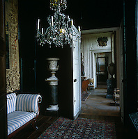 Many of the rooms in this 17th century French chateau are furnished with antiques and decorated with chandeliers and urns on pedestals