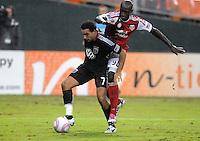 D.C. United forward Dwayne De Rosario (7) goes against Portland Timbers defender Mamadou Danso (98). D.C. United tied The Portland Timbers 1-1at RFK Stadium, Wednesday October 19, 2011.