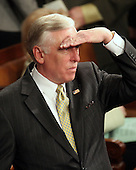 Washington, D.C. - January 4, 2007 --  United States Representative Steny H. Hoyer (Democrat of the 5th District of Maryland), the Majority Leader, shields his eyes from the glare of the TV lights as he scans the House floor during the vote for United States Representative Nancy Pelosi (Democrat of the 8th District of California) as Speaker of the United States House of Representatives in the Capitol in Washington, D.C. on Thursday, January 4, 2007.  Speaker Pelosi is the first woman in U.S. history to serve in that position..Credit: Ron Sachs / CNP