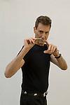 Uri Geller at home Berkshire England 2008. Bending spoon 3rd image taken at 16. 36. 28 pm.