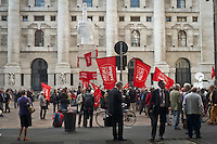 The middle finger sculpure of Maurizio Cattelan coverd of Tsipras red flag during the presentation of Italy's Tsipras List in Piazza Affari (Milan Stock Exchange) , on April 23, 2014. Photo: Adamo Di Loreto/BuenaVista*Photo