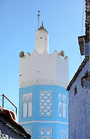 Minaret with blue and white stucco facade in the medina or old town of Chefchaouen in the Rif mountains of North West Morocco. Chefchaouen was founded in 1471 by Moulay Ali Ben Moussa Ben Rashid El Alami to house the muslims expelled from Andalusia. It is famous for its blue painted houses, originated by the Jewish community, and is listed by UNESCO under the Intangible Cultural Heritage of Humanity. Picture by Manuel Cohen