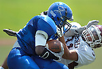 Jodi Miller Lubbock Avalanche-Journal.Estacado's Davoyea Johnson(21) is brought down by Hereford's Jordan Armendariz(31) during Saturday afternoon's game at Lowrey Field.