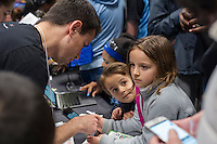 Workers from Google interact with young visitors at a Career Expo held at the FIRST Robotics NYC Championship at the Jacob Javits Convention Center in New York on Sunday, March 13, 2016. The expo enables participants to speak with companies and professional organizations giving a real-world look into science and technology as used in the business world and their career opportunities. (© Richard B. Levine)