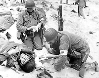 Medics helping injured soldier, France, 1944. (OWI)<br /> Exact Date Shot Unknown<br /> NARA FILE #:  208-YE-22<br /> WAR &amp; CONFLICT #:  909