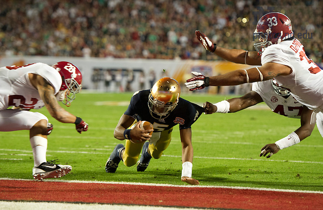 Jan. 7, 2013; Quarterback Everett Golson scores a fourth quarter touchdown past Alabama defense during the 2013 BCS National Championship in Miami, Florida. Alabama defeated Notre Dame 42 to 14. Photo by Barbara Johnston/University of Notre Dame