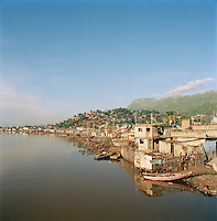 Houses built on the river banks at Cap-Haïtien on the north coast of Haiti