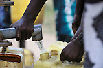 A woman in Yei, Southern Sudan, getting water from a well provided by the United Methodist Committee on Relief (UMCOR).