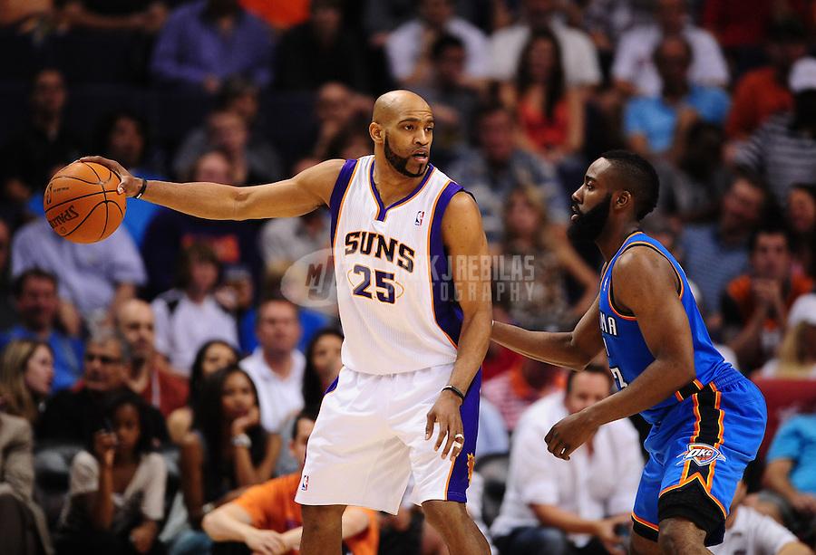 Mar. 30, 2011; Phoenix, AZ, USA; Phoenix Suns guard (25) Vince Carter against Oklahoma City Thunder guard (13) James Harden at the US Airways Center. Mandatory Credit: Mark J. Rebilas-.