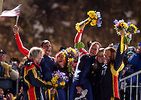 USA's Vonetta Flowers and Jill Bakken celebrate their gold medal win surrounded by the German teams that took silver and bronze in the women's bobsleigh event during the Winter Olympics in Park City, Utah, on Feb. 19, 2002. Flowers was the first African American woman to win gold in the Winter Olympic games.