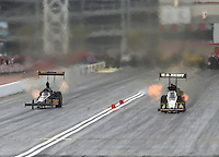 Mar 30, 2014; Las Vegas, NV, USA; NHRA top fuel driver Troy Buff (left) races alongside Tony Schumacher during the Summitracing.com Nationals at The Strip at Las Vegas Motor Speedway. Mandatory Credit: Mark J. Rebilas-
