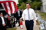 GOP presidential candidate Gov. Mitt Romney presents a fire extinghuisher, and a new truck, to a supporter at a campaign rally at EIT LLC, and electronics design and manufacturing company, in Sterling, Virginia, June 27, 2012.