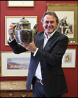 BNPS.co.uk (01202 558833)<br /> Pic: HAldridge/BNPS<br /> <br /> Flog It presenter Paul Martin with the battered old teapot.<br /> <br /> A man who took an old silver teapot along to TV's Flog It is celebrating today after it led to a record 140,000 pounds sale.<br /> <br /> Experts on the BBC show valued the item, that originated from the Far East, at 120 pounds, prompting the owner to reveal he had five other heirlooms at home.<br /> <br /> After digging the relics out he sold them at auction for the six figure sum, setting a record for the highest amount ever achieved on the popular programme.<br /> <br /> The show is very much like the Antiques Roadshow except that people go on to sell their treasures at auction which is also filmed by the Beeb.<br /> <br /> The unnamed owner took the 12ins tall teapot along to a valuation day held last month at Longleat House, Wilts.
