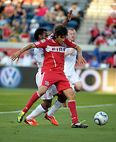 Chicago midfielder Sebastian Grazzini (10) shields the ball from Toronto midfielder Julian de Guzman (6).  The Chicago Fire defeated Toronto FC 2-0 at Toyota Park in Bridgeview, IL on August 21, 2011.
