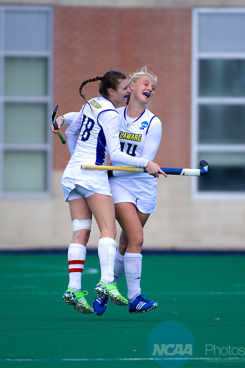 NORFOLK, VA - NOVEMBER 20:  Kiki Bink (14) and Maura Zarkoski (18) of the University of Delaware celebrate a goal against the University of North Carolina during the Division I Women's Field Hockey Championship held at the LR Hill Sports Complex on November 20, 2016 in Norfolk, Virginia.  Delaware defeated North Carolina 3-2 for the national title. (Photo by Jamie Schwaberow/NCAA Photos via Getty Images)