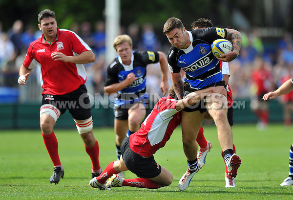 Matt Banahan goes on the attack. Pre-season friendly match, between Bath Rugby and London Welsh on August 11, 2012 at the Recreation Ground in Bath, England. Photo by: Patrick Khachfe / Onside Images