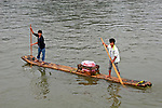 Asia, China, Guangxi, Guilin, Li River.  Life along the Li River involves locals paddling rafts to sell trinkets to visitors on passing cruiseboats.