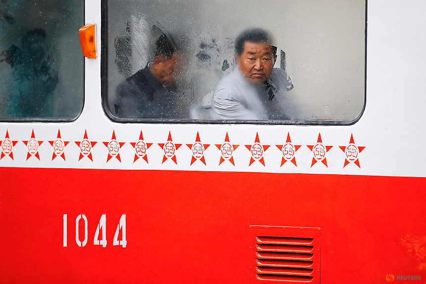 A man looks through the foggy window of a tram on a rainy day in central Pyongyang, North Korea April 14, 2017.    REUTERS/Damir Sagolj