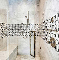 This custom shower features Edie, a handmade mosaic shown in Nero, Bardiglio, Thassos and Carrara, is part of the Silk Road Collection by Sara Baldwin for New Ravenna.<br />