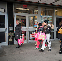 Shoppers with their ubiquitous Victoria's Secret shopping bags in the Herald Square shopping district in New York looking for bargains on Thursday, November 29, 2012. (© Richard B. Levine)