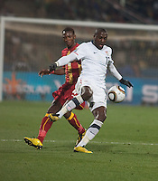 Ghana's John Pantsil and the USA's Jozy Altidore fight for a loose ball  in a second round match of the 2010 FIFA World Cup between USA and Ghana in Rustenberg, South Africa on Saturday, June 26, 2010.  Ghana won 2-1.