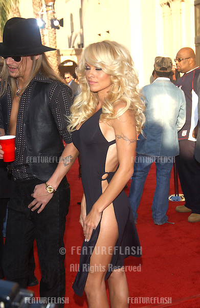 PAMELA ANDERSON & KID ROCK at the 31st Annual American Music Awards in Los Angeles..November 16, 2003