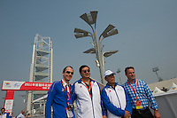 Alain Rumpf (Global Cycling Promotion) and other race organizers pose for snapshots before the start of the day's ITT - 2011 Tour of Beijing, Stage 1 ITT