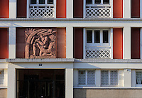 Detail of the facade of the apartment block at 50 Avenue Foch, with stone relief by Pierre Colombo, designed by Auguste Perret, 1874-1954, who led the reconstruction of Le Havre in the 1950s, after the town was completely destroyed in WWII, Le Havre, Normandy, France. Avenue Foch is one of the widest avenues in Europe and forms part of the 'Monumental Triangle' at the heart of Le Havre's reconstruction plans. The centre of Le Havre is listed as a UNESCO World Heritage Site. Picture by Manuel Cohen