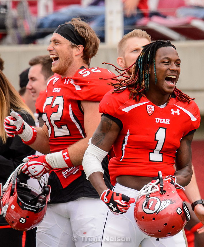 Trent Nelson  |  The Salt Lake Tribune<br /> Boobie Hobbs cheers from the sideline at the Utah Football Red &amp; White game in Salt Lake City, Saturday April 25, 2015.