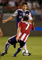 Pachuca FC midfielder Marco Vidal (6) attempts to move around Chivas USA midfielder Osael Romero (7). CD Chivas USA defeated Pachuca FC 1-0 during 2010 SuperLiga group play at Home Depot Center stadium in Carson, California on Wednesday July 21, 2010..
