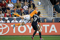 Jack McInerney (19) of the Philadelphia Union fouls Andre Hainault (31). The Philadelphia Union and the Houston Dynamo played to a 1-1 tie during a Major League Soccer (MLS) match at PPL Park in Chester, PA, on August 6, 2011.