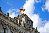 The German flag flies on top of the Reichstag, the German Parliament building in Berlin
