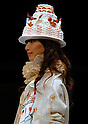 A model appears with a big cake hat at the Tokyo Sweets Collection 2008 which was held on Saturday, November 8, 2008, in collaboration with 14 popular Japanese pastry chefs and designer Tsumori Chisato.