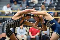 NWA Democrat-Gazette/JASON IVESTER<br /> Bentonville's Cash Jones wrestles against Bentonville West's Michael Kirmer on Thursday, Jan. 26, 2017, at Bentonville High School.