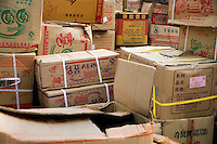 Boxes of goods wait for shipment in a wholesale market in Urumqi, Xinjiang, China.