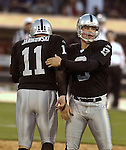 Oakland Raiders punter Shane Lechler (9) congratulates kicker Sebastian Janikowski (11) on Saturday, August 24, 2002, in Oakland, California. The Raiders defeated the 49ers 17-10 in a preseason game.