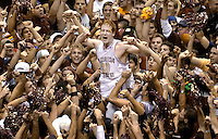 TALLAHASSEE, FL. 1/25/04-Florida State's Andrew Wilson is lifted up by a mob of celebrating Seminole fans after FSU beat Wake Forest 75-70 Sunday at the Tallahassee-Leon County Civic Center. COLIN HACKLEY PHOTO