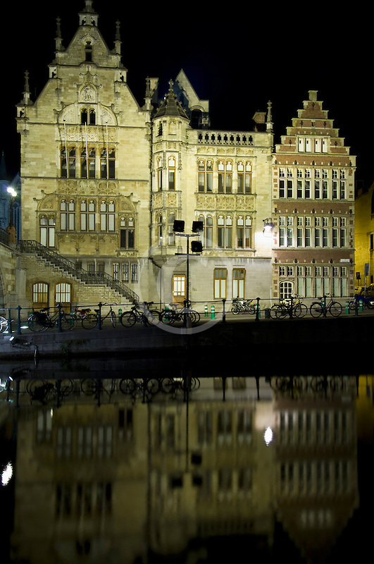 Belgium, Ghent, Gabled guild houses on Graslei canal at night