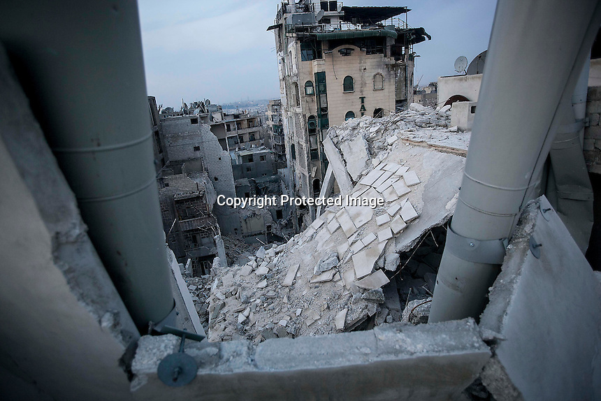 In this Thursday, Nov. 29, 2012 photo, destroyed buildings, among those the Dar Al-Shifa hospital (at the bottom), are seen in Sa'ar street after a warplane targeted the hospital last week killing dozens among medical staff and civilians in Aleppo, the Syrian's largest city. (AP Photo/Narciso Contreras).