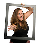 Beth Ziegenhorn holds a picture frame in Oxford, Miss. on Tuesday, August 30, 2011.