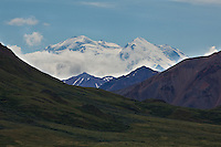 For a brief moment Mt. McKinley cleared almost completely, making both the north and south summits visible from the park road. The north summit stands at 19,470 feet, while the south summit reaches 20,320 feet.