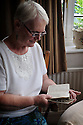 BARBARA BURNS WITH THE NEW TESTAMENT OF HER GRAND FATHER ALFRED ALGAR.
