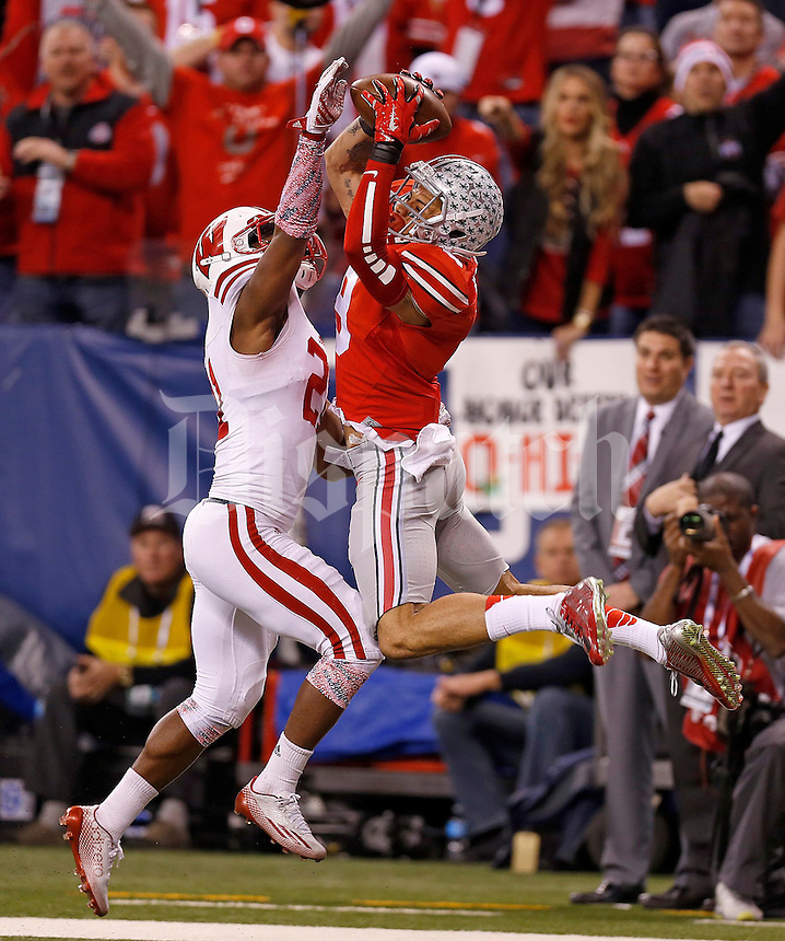 Ohio State Buckeyes wide receiver Devin Smith (9) makes a touchdown catch over Wisconsin Badgers cornerback Peniel Jean in the third quarter of the Big Ten Championship game at Lucas Oil Stadium in Indianapolis on Saturday, December 6, 2014. (Columbus Dispatch photo by Jonathan Quilter)