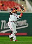 28 September 2010: Philadelphia Phillies' infielder Jimmy Rollins pulls in a shallow fly during game action against the Washington Nationals at Nationals Park in Washington, DC. The Nationals defeated the Phillies 2-1 on an Adam Dunn walk-off solo homer in the 9th inning to even up their 3-game series one game apiece. Mandatory Credit: Ed Wolfstein Photo