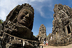 Tourists visit the Bayon Temple in the ancient city of Angkor Thom, in northwestern Cambodia, near Siem Reap.