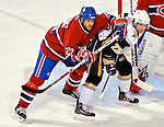 31 March 2007: Montreal Canadiens defenseman Mathieu Dandenault (25) checks Buffalo Sabres center and team co-captain Chris Drury (23) in front of the Canadien's net at the Bell Centre in Montreal, Canada...Mandatory Photo Credit: Ed Wolfstein Photo *** Editorial Sales through Icon Sports Media *** www.iconsportsmedia.com